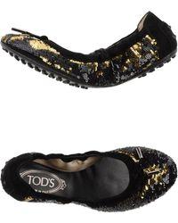 Tod's Ballet Flats gold - Lyst