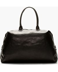 Ann Demeulemeester - Black Leather Side Strap Duffle Bag - Lyst