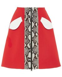Carven Mini Skirt With Snakeskin Printed Front Panel red - Lyst