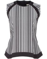 O'2nd Sleeveless Striped Peplum Top - Lyst