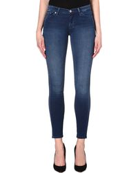 7 For All Mankind The Skinny Mid Rise Jeans Indigo - Lyst