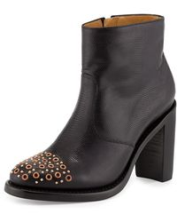 The Office Of Angela Scott - Stamped Leather Grommet-toe Bootie - Lyst
