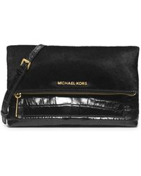Michael Kors Jet Set Travel Embossed-Leather Clutch - Lyst
