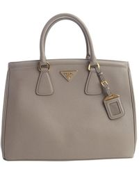 Prada Grey Textured Leather Top Handle Bag - Lyst
