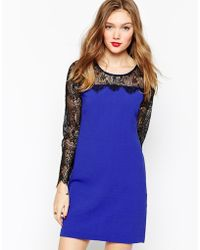 Aryn K. Bodycon Dress With Contrast Lace Sleeves - Lyst