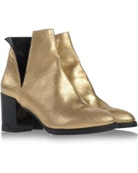 Miista Silver Ankle Boots - Lyst