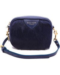 Deadly Ponies Mr. Cub Fur Cross Body Bag - Cobalt blue - Lyst