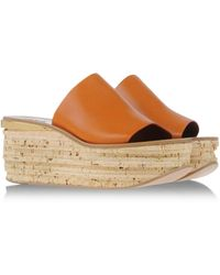 Chloé Mules & Clogs orange - Lyst