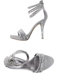 Guess Sandals silver - Lyst