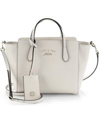 Gucci Swing Small Crossbody Bag white - Lyst