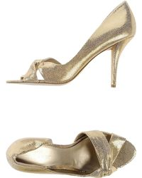 Nine West Court gold - Lyst