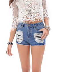 Forever 21 Destroyed Denim Cutoffs - Lyst
