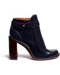 90cc06ce9b4957 ... new zealand tory burch hyde kiltie flap leather boots lyst 1987b a99fb
