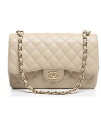 Chanel Pre-Owned Ivory Caviar Jumbo Double Flap Bag - Lyst