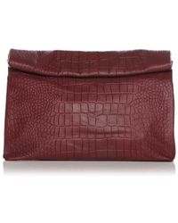 Marie Turnor Pebble Lunch Clutch purple - Lyst