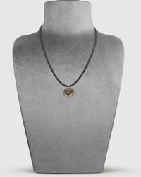Gucci - Woven Leather Necklace With Crest Pendant - Lyst