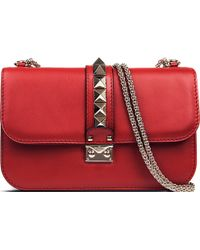 Valentino Lock Stud Leather Clutch Bag - For Women - Lyst