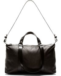Costume National Black Grained Leather Duffle Bag - Lyst