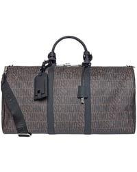 Moschino - Logo Duffle Bag - Lyst