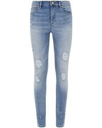 Juicy Couture Glamour Distressed Skinny Jeans - Lyst
