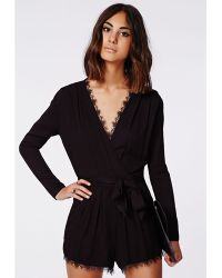Missguided Myra Lace Trim Tie Front Wrap Playsuit Black - Lyst