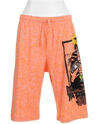 Jeremy Scott Bermuda Shorts orange - Lyst