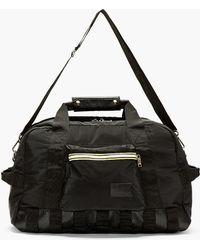Kris Van Assche - Black Padded Nylon Convertible Duffle Bag - Lyst