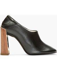 Stella McCartney Black Convertible Mule Pumps - Lyst