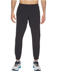 Asics - Condition Stretch Woven Pants - Lyst