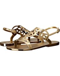db7a54d93657 Lyst - Stuart Weitzman Gelfisher Laser-Cut Jelly Sandals in Metallic