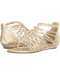 50fc56af2eeea Lyst - G By Guess Jonsie Strappy Flat Sandals in Metallic