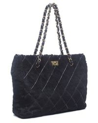 Chanel Preowned Black Fur Quilted Shoulder Bag - Lyst