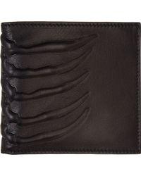 Alexander McQueen Black Leather Ribcage Embossed Bifold Wallet - Lyst