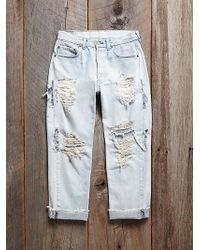 Free People Vintage Destroyed Levis Jeans - Lyst