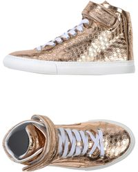 Pierre Hardy High-Tops & Trainers gold - Lyst