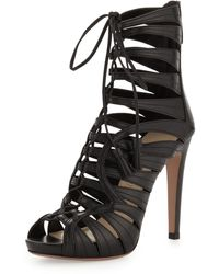 Prada Strappy Leather Tassel Bootie - Lyst
