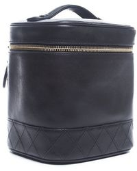 Chanel Black Lambskin Vertical Cosmetic Case - Lyst