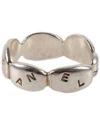 Chanel Pre-Owned Silver Nameplate Ring - Lyst