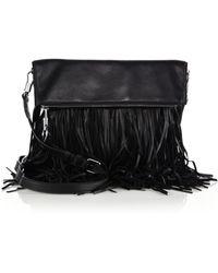 Elizabeth and James Andrew Fringed Leather Foldover Crossbody Bag black - Lyst