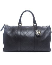 Chanel Pre-owned Black Lambskin Boston Travel Bag - Lyst