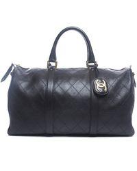 Chanel Pre-owned Black Lambskin Boston Travel Bag - Lyst