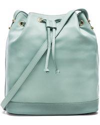 Karen Walker Enid Bucket Bag blue - Lyst