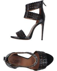 Alaïa Sandals black - Lyst