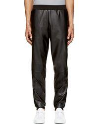 Versus  Black Leather Look Trousers - Lyst