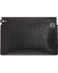 Loewe Logo-embossed Large Leather Pouch - Lyst