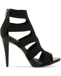 Calvin Klein Women'S Navi Dress Sandals black - Lyst