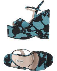 Miu Miu Sandals green - Lyst