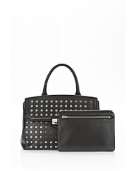 Alexander Wang Large Marion Sling In Black With Eyelets And Rhodium - Lyst