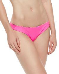 Zinke - Emmi Solid/Floral-Print Reversible Swim Bottom - Lyst