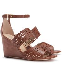 Tory Burch Perforated Gladiator Wedge - Lyst